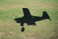 Midair Shadow while Landing in a Small Airplane at Vansant Airport. Image taken with a Nikon 1 V1 and 10-100 mm VR lens (ISO 100, 14.4 mm, f/4.8, 1/320 sec).