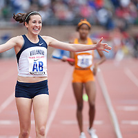 Sheila Reid of Villanova University celebrates after crossing the finish line first following the College Women's Distance Medley Championship during the Penn Relays athletic meets on Thursday, April 26, 2012 in Philadelphia, PA.