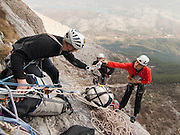 Leo Houlding and Tim Emmett hauling bags, Monte Brento