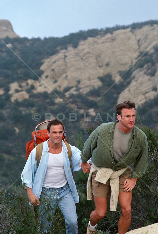 Two Guys Holding Hands Two Men Holding Hands Hiking
