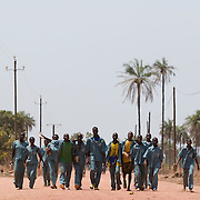 A group of students in school uniforms walk back from school near the village of Kabiline, Senegal on Wednesday June 13, 2007.....