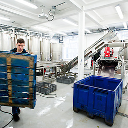 London, UK - 15 October 2013: a man moves a pallet at the new London Cru urban winery. The building in Earl's Court will open to the public in November for informative tours and wine tastings.