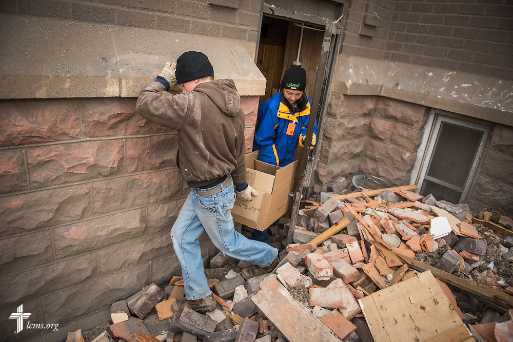Volunteers attempt to salvage cherished items from Zion Lutheran Church on Monday, May 11, 2015, in Delmont, S.D. A tornado swept through the area the previous day and destroyed the church and nearby buildings. LCMS Communications/Erik M. Lunsford