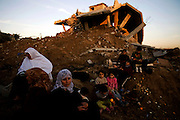 Members of the Abed Rabo family sit in the dirt beneath their home that was destroyed by the Israeli army in the Abed Rabo neighborhood of Jablaya, Gaza January 22,2009. (Photo by Heidi Levine/Sipa Press).