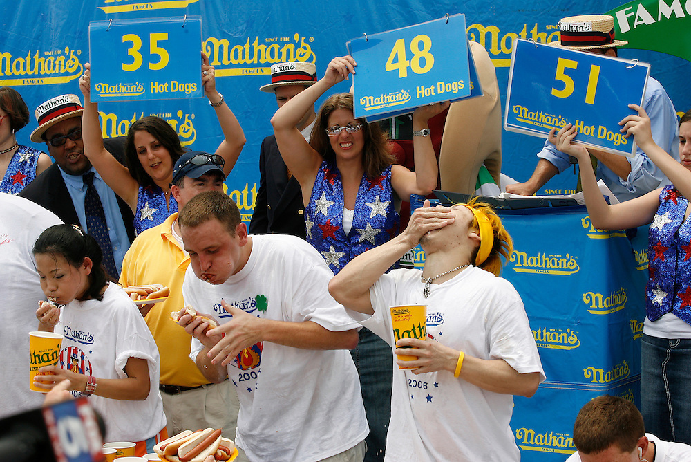 NEW YORK, NY-06 JUL04-- Takeru Kobayashi narrowly beat American favourite Joey Chestnut in the final seconds of the hot dog eating competition (Extra) The Gazette/Liam Maloney