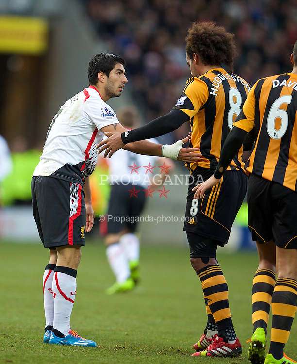 HULL, ENGLAND - Sunday, December 1, 2013: Liverpool's Luis Suarez clashes with Hull City's Tom Huddlestone during the Premiership match at the KC Stadium. (Pic by David Rawcliffe/Propaganda)
