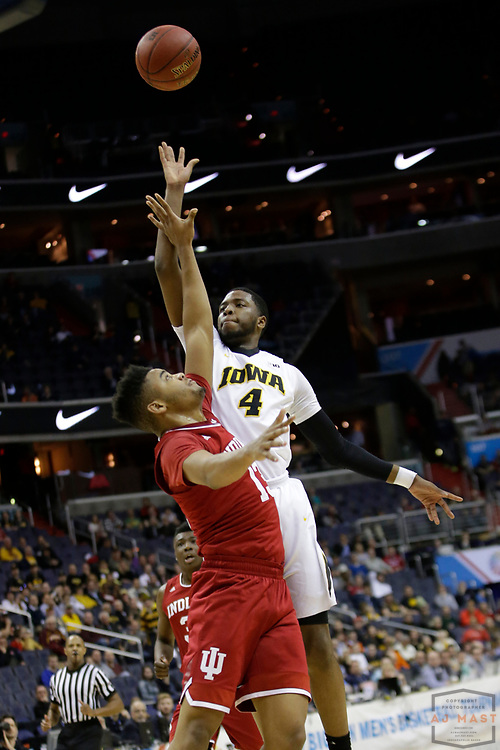 Iowa guard Isaiah Moss (4) in action as Indiana played Iowa in an NCCA college basketball game in the second tournament in Washington, D.C., Thursday, March 9, 2017. (Photo by AJ Mast)