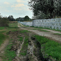 Razor-wire border fence along the Hungarian border with Serbia. The Hungarian authorities were in the process of reinforcing it, to stop refugees and migrants passing through on their way to Western Europe.