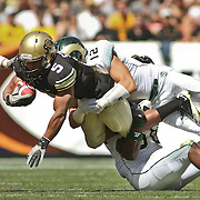 SHOT 9/17/11 12:46:55 PM - Colorado's Rodney Stewart #5 is gang tackled by Colorado State's James Skelton #43, Austin Gray #12 and  Shaquil Barrett #56 during the Mile High Showdown game at Sports Authority Field at Mile High Stadium. Colorado won the in-state rivalry game 28-14. (Photo by Marc Piscotty /  © 2011)