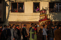 Buddhists in Patan march through the streets of the old city as part of a religious festival.