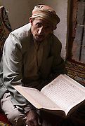 Man reading Koran in Mosque.