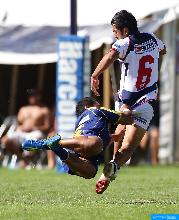 Rocky Kahn, Auckland, is tackled by Buxton Popoali'i during the final of the Pub Charity Rugby Sevens 2012 New Zealand tournament at the Queenstown Recreation Ground, Queenstown, Otago, New Zealand. 8th January 2012. Photo Tim Clayton
