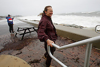 Marcia Lay of Plymouth, Massachusetts watches the ocean waves that have been kicked up with the approach of Hurricane Sandy at Long Beach in Plymouth, Massachusetts on October 21, 2012.  A state of emergency was declared in the state on Saturdy.  UPI/Matthew Healey