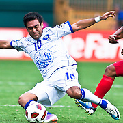 EL Salvador Attacker Eliseo Quintanilla #10 slide kicks the ball in the midst of the concacaf gold cup quarterfinals Sunday, June 19, 2011 at RFK Stadium in Washington DC.