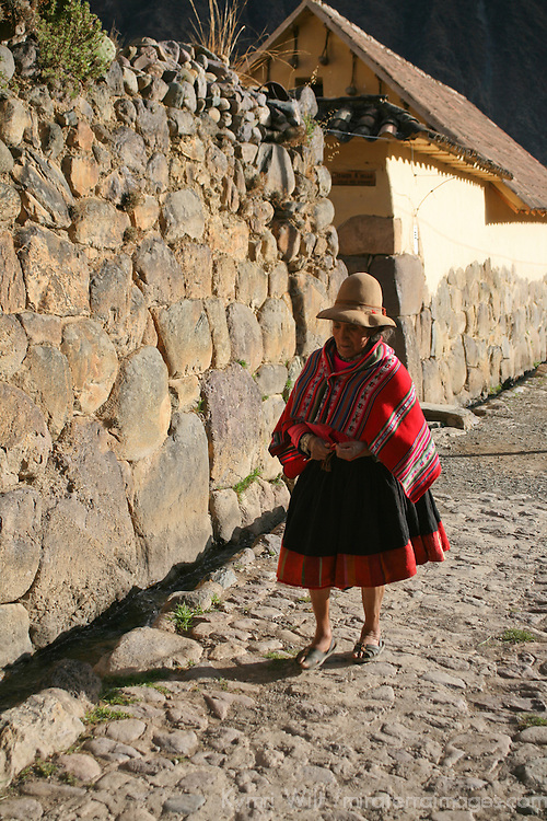 South America, Peru, Ollanta. Peruvian woman walking Incan street of Ollanta.