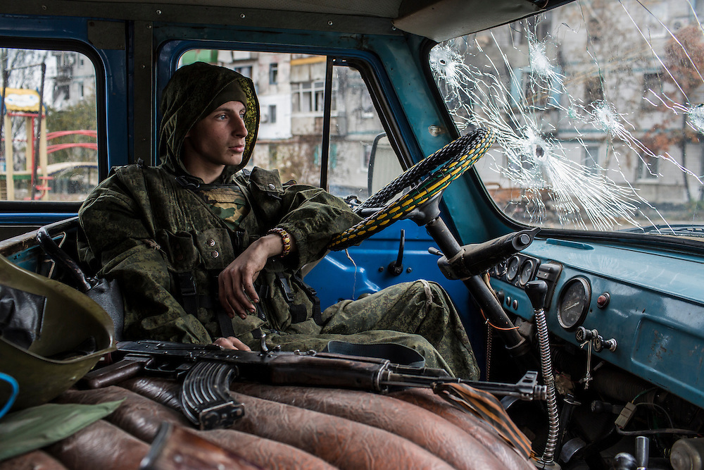 A pro-Russian rebel fighter sits in a van in the Kievsky district where they coordinate fighting to gain control of the Donetsk airport on Friday, October 17, 2014 in Donetsk, Ukraine. Photo by Brendan Hoffman, Freelance
