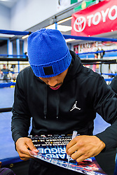 Rancho Cucamonga, California/USA (Tuesday, Nov 12 2013) - Super middleweight champion Andre Ward (26-0, 14 KOs) signs autographs for his fans prior to his open workout during the Ward vs Rodriguez Media Workout at the Warzone Boxing Club in Rancho Cucamonga, CA USA. Andre have not fought in over a year due to right shoulder surgery. He is facing Edwin Rodriguez (24-0, 16 KOs) at the Citizens Business Bank Arena in Ontario, California. The Ward-Rodriguez bout will be televised live on HBO at 9:30PM PST. PHOTO © SILVEXPHOTO.COM.