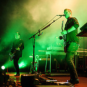 """COLUMBIA, MD - July 17th, 2014 - Troy Van Leeuwen and Josh Homme of Queens of the Stone Age perform at Merriweather Post Pavilion. The band's 2013 album, """"…Like Clockwork,"""" was the group's first album to top the US Billboard 200 album charts. (Photo by Kyle Gustafson / For The Washington Post)"""