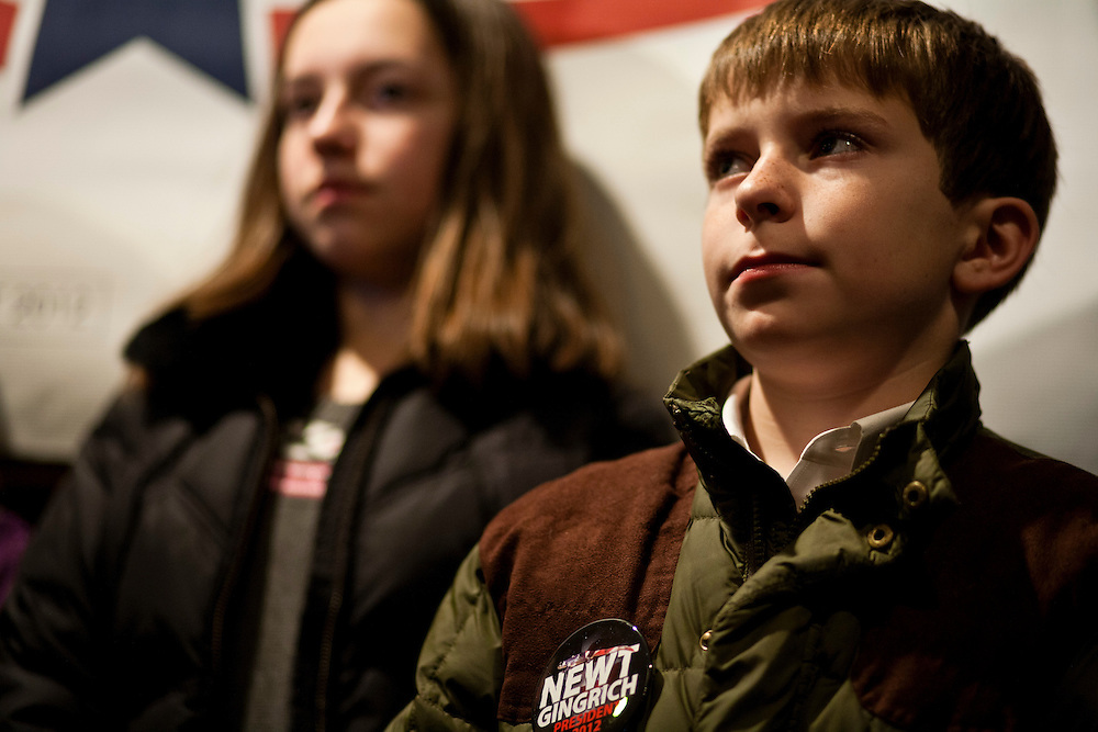Children listen as Republican presidential candidate Newt Gingrich speaks at Tish's Restaurant on Saturday, December 31, 2011 in Council Bluffs, IA.