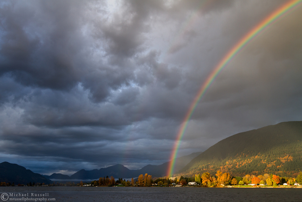 A rainbow over Hatzic Lake and Hatzic Island during a rainstorm near Mission, British Columbia, Canada.  Photographed from Neilson Regional Park in Mission, BC.
