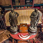 Goethe and Schiller statues in cozy library. Compass Rose Bed & Breakfast. Coupeville, Washington, USA. This fine 1890 Queen Anne Victorian home, on the National Register of Historic Places, is now an elegant two room bed and breakfast, furnished with antiques and glorious things from around the globe by the hosts, Captain and Mrs. Marshall Bronson.