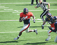 Nicholas Parker (4) is chased by Brishen Mathews (13) at Ole Miss football scrimmage at Vaught-Hemingway Stadium in Oxford, Miss. on Saturday, April 6, 2013.