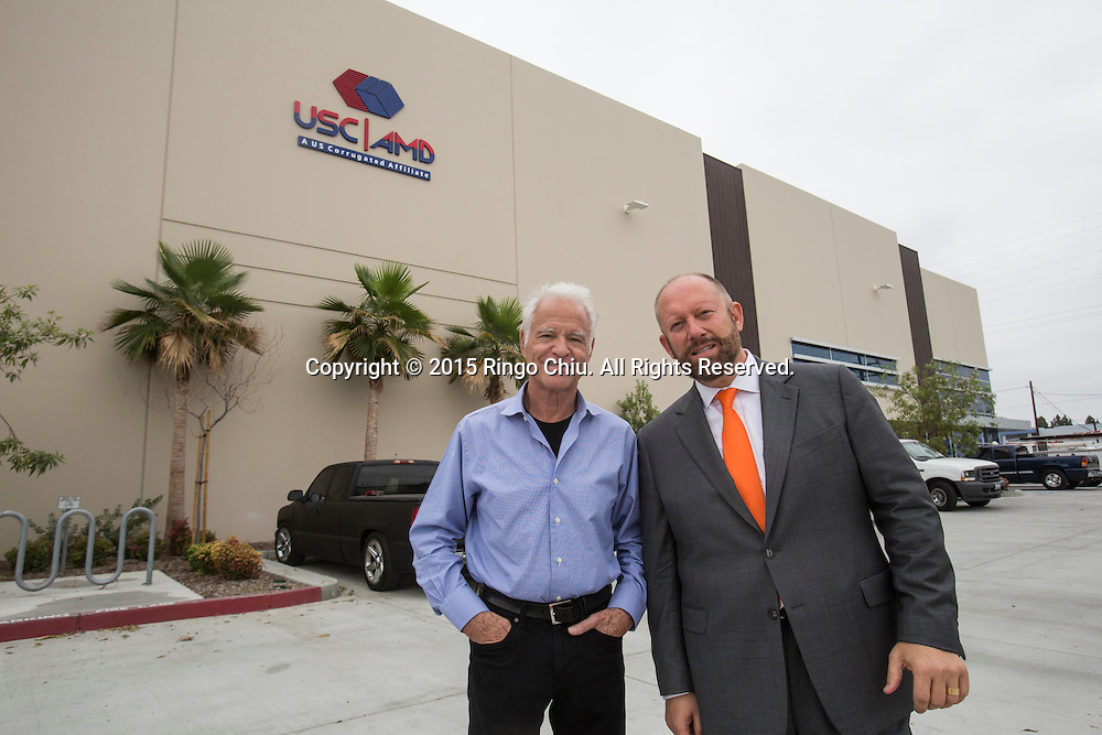 David Weissberg, right, CEO of Acorn Paper Products Co., and Dennis Mehiel of  Acorn Paper Products Co.. <br /> Photo by Ringo Chiu/PHOTOFORMULA.com)