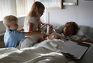 Bariatric surgical patient Carolyn Dawson (R) is visited by her family including son Kevin (L) and daughter Katya (C) shortly after Dawson underwent laparoscopic gastric bypass at Rose Medical Center in Denver August 30, 2010 performed by Dr. Michael Snyder. Dawson hoped to lose almost 150 pounds with the help of the procedure. REUTERS/Rick Wilking (UNITED STATES)