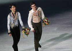 Silver medalist Yuzuru Hanyu (L) of Japan and gold medalist Javier Fernandez of Spain skate together during a victory ceremony for the Men at the ISU World Figure Skating Championships at Shanghai Oriental Sports Center in Shanghai, China, 28 March 2015.