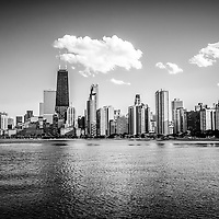 Black and white picture of Gold Coast Chicago skyline with the Hancock building.  The Chicago Gold Coast is part of the Chicago Near North Side in Chicago. The John Hancock Center Building is a famous part of the Chicago skyline and is one of the tallest skyscrapers in the world.