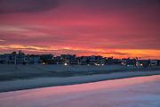 A fiery sunrise colors the sky red over Venice Beach, Venice, California.