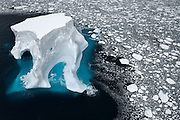 An iceberg floats in sea ice of the Ross Sea, February, 2007.