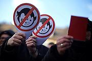 Frankfurt am Main | 30 Mar 2015<br /> <br /> Am Montag (30.03.2015) demonstrierten etwa 40 Menschen unter dem Namen &quot;Freie B&uuml;rger f&uuml;r Deutschland&quot; auf dem R&ouml;merberg in Frankfurt am Main gegen Islamisierung und zahlreiche andere &Uuml;bel, die Gruppe war zuvor unter dem Namen &quot;PEGIDA&quot; aufgetreten. Etwa 600 Menschen protestierten lautstark gegen diese Kundgebung.<br /> Hier: Gegendemonstranten mit kleinen Plakaten mit einer stilisierten Zeichnung einer durchgestrichenen Frau, gemeint ist die PEGIA-Aktivistin Heidi Mund (#tittenhitler).<br /> <br /> &copy;peter-juelich.com<br /> <br /> [No Model Release | No Property Release]