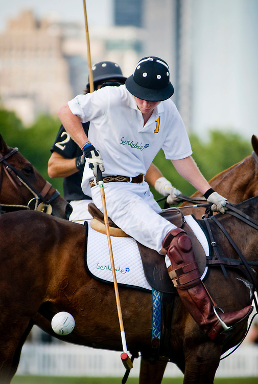 Prince Harry Competes In The 2009 Veuve Clicquot Manhattan Polo Classic on Governor's Island. Harry played for the Sentebale team, competing against the Black Watch team..
