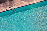 Overhead view of a section of a swimming pool. Bright sunlight on brilliant blue water. WATERMARKS WILL NOT APPEAR ON PRINTS OR LICENSED IMAGES.