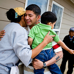 033110        Brian Leddy.Juan Espinoza hugs Bonnie Henio after arriving in Pine Hill with his wife Alvina. Espinoza is originally from Texas while Alvina grew up in Pine Hill.