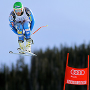 SHOT 12/1/11 12:32:50 PM - U.S. skiier Bode Miller launches himself off the Red Tail jump during men's downhill training on the Birds of Prey course at the Audi FIS World Cup on December 1, 2011 in Beaver Creek, Co. (Photo by Marc Piscotty / © 2011)