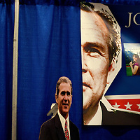 ORLANDO, FL -- September 23, 2011 -- Glimpse of former President George W. Bush are seen at a booth during the Conservative Political Action Conference (CPAC) at the Orange County Convention Center in Orlando, Fla., on Friday, September 23, 2011.  (Chip Litherland for The New York Times)