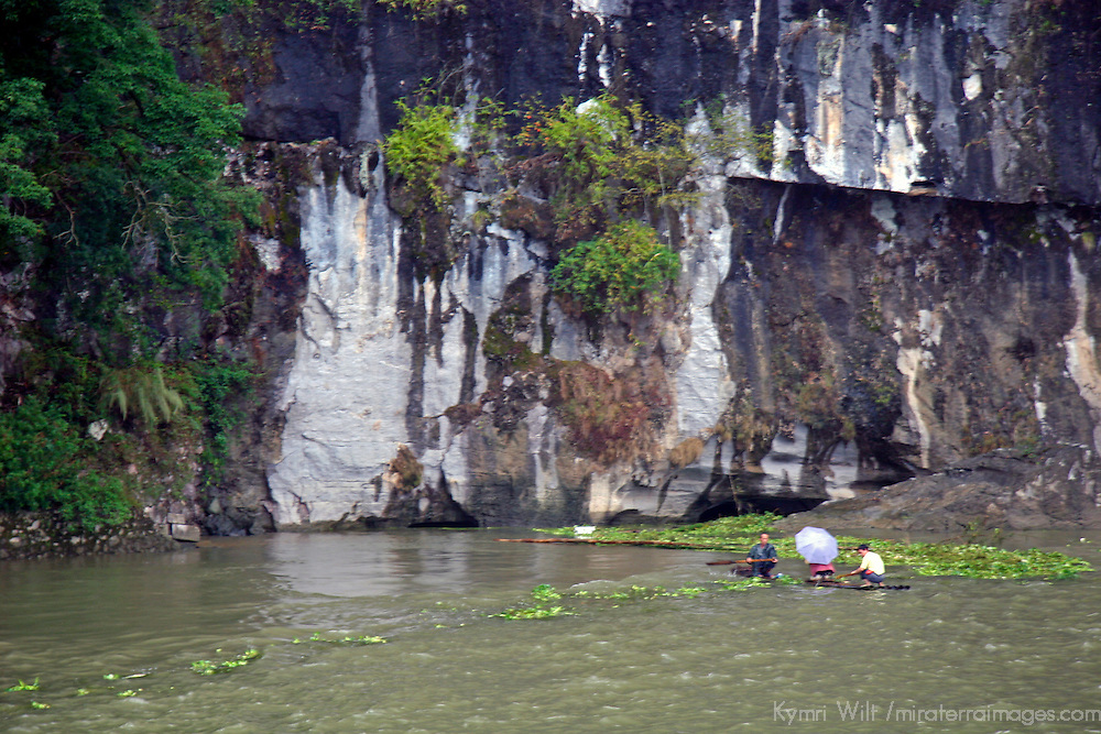Asia, China, Guangxi, Guilin, Li River. Locals rafting amongst the greenery of the Li JIang river.