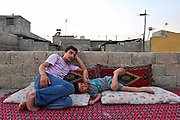 Relaxing on their roof in Gaziantep, they are among the first generation of the tribe to grow up entirely in an urban environment