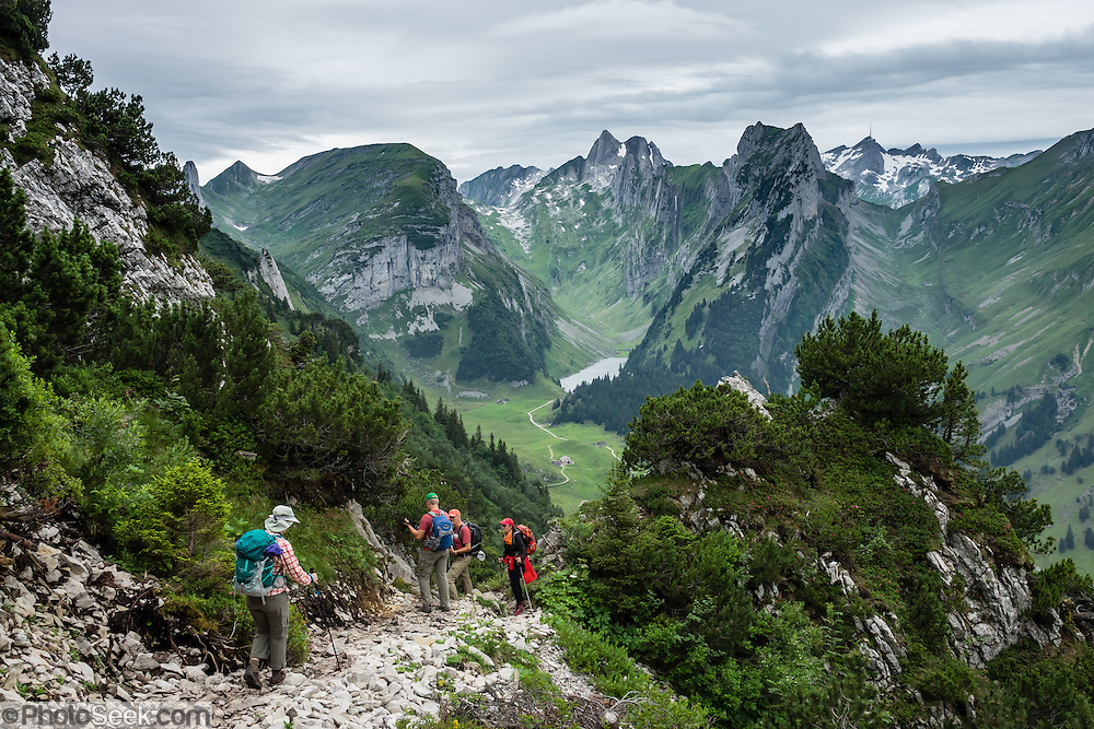 Hiking on ridge above  the lake of Fälensee in the Alpstein range, Appenzell Alps, Switzerland, Europe. Fälensee (1446 m) is in a narrow valley between Hundsteingrat and Roslen-Saxer First. Appenzell Innerrhoden is Switzerland's most traditional and smallest-population canton (second smallest by area).