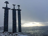 Three enormous bronze swords stand monument to the battle of Hafrsfjord in the year 872, when Harald H&aring;rfagre (Fairheaded Harald) united Norway into one kingdom. The monument was designed by Fritz R&oslash;ed (1928 - 2002) from Bryne, just south of Stavanger. It was unveiled by Norway's King Olav in 1983.<br /> &nbsp;<br /> &nbsp;<br /> The swords, which are about 10 meters tall, stand for peace and unification. One sword is larger than the others. This was Fairheaded Harald's sword. The swords are planted in solid rock - representing peace and are found at M&oslash;llebukta which is a bay area on the southern shore of Hafrsfjord.<br /> The name &quot;M&oslash;llebukta&quot; derives from &quot;m&oslash;lla&quot; (mill) and &quot;bukt (bay). There used to be a corn mill here. Today the area is one of Stavangers most popular recreational areas.