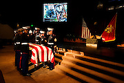 The Marine Honor Guard salutes the casket carrying Lt. Madrazo in the church...Service (Funeral) for Lt. Nicolas Madrazo of Bothell, Washington. Killed in Action September 9, 2008 in Afghanistan...Westminster Chapel, Bellevue, Washington.