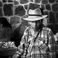 Man with hat shopping at the market in San Pedro de Lagoona by Lake Atitlán (Lago de Atitlán) in Guatemala