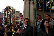 A procession carries the image of St. Clare through the streets of Ayacucho, Peru, during Holy Week.