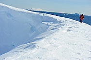 Tourist advances over a ridge at Portal Point in Antarctica.Model Released photo.