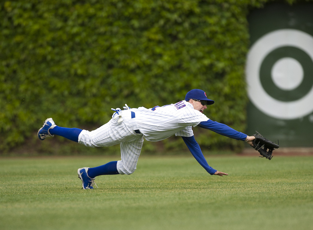 CHICAGO - MAY  04:  Tony Campana #1 of the Chicago Cubs dives but cannot catch the baseball against the Los Angeles Dodgers on May 4, 2012 at Wrigley Field in Chicago, Illinois.  The Cubs defeated the Dodgers 5-4.  (Photo by Ron Vesely)   Subject:  Tony Campana