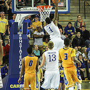 Delaware Guard Jarvis Threatt (4) drives to the basket for the high percentage dunk in the second half of a NCAA regular season Colonial Athletic Association conference game between Delaware and Hofstra Wednesday, JAN 8, 2014 at The Bob Carpenter Sports Convocation Center in Newark Delaware.