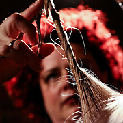 Hairstylist Cynthia Peditto Hansbury cutting model Kelly hair during Scissor Candy open chair 12 Sunday, Apr. 27, 2014 at National Mechanic in Philadelphia Pennsylvania.