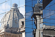 The National Museum of Romanian History and apartments reflected in the facade of Bucharest Financial Plaza, on Victory Road, Bucharest, Romania
